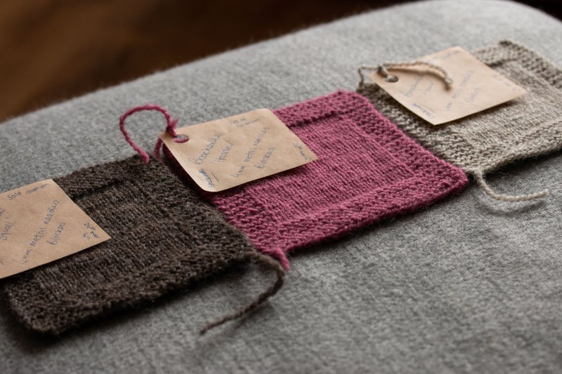 Hand Knit Swatches in Stockinette with garter stitch border pink and grey